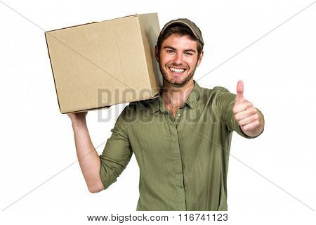 Handsome postman holding pack showing thumbs up on white screen
