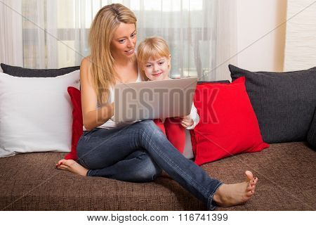 Mother and daughter looking at something in computer