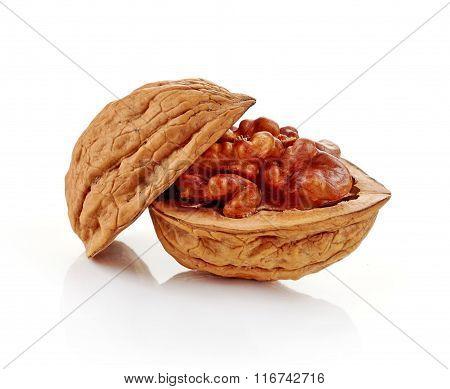 Cracked walnut on white background