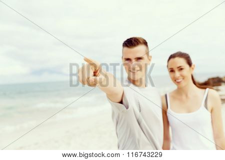 Couple of runners standing together on beach