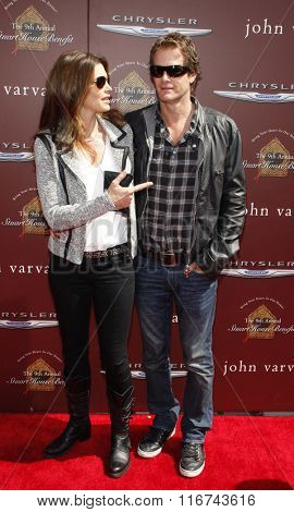 Cindy Crawford and Rande Gerber at the John Varvatos 9th Annual Stuart House Benefit Presented By Chrysler And Hasbro held at the John Varvatos Boutique, California, United States on March 11, 2012.