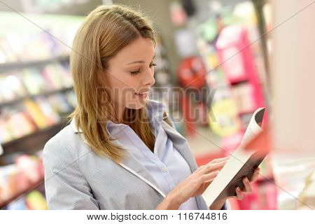 Woman customer shopping in book store