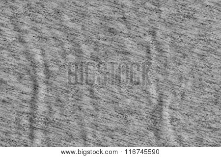 Wave on gray crumpled fabric background.