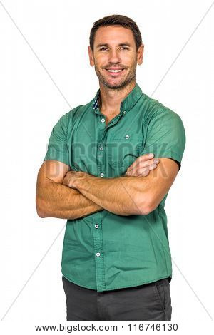Smiling man with arms crossed on white screen