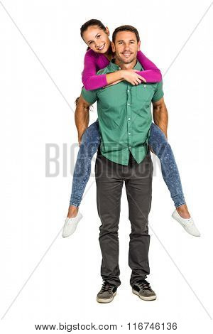 Happy couple giving piggy back on white screen
