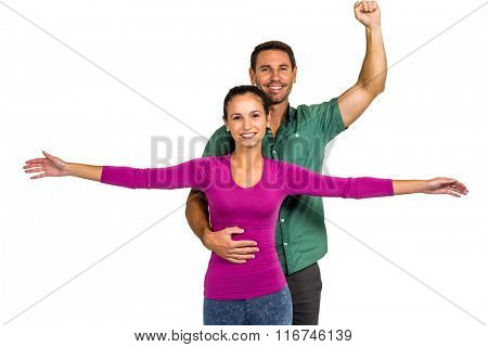 Couple posing for camera on white screen