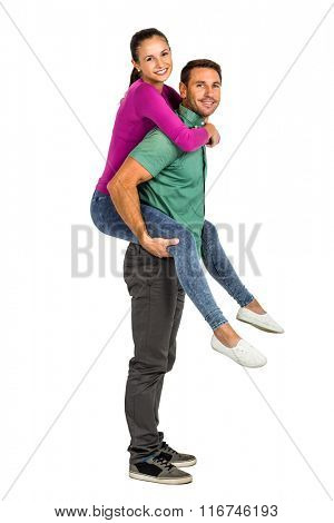 Smiling couple giving piggy back on white screen