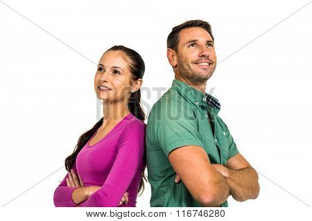 Thoughtful couple standing back to back looking away on white screen