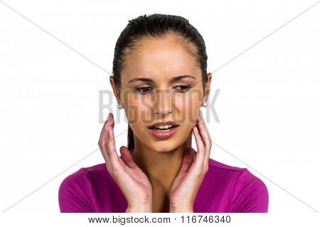 Sad woman standing on white background