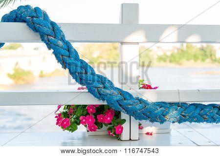 Blue Rope On White Fence