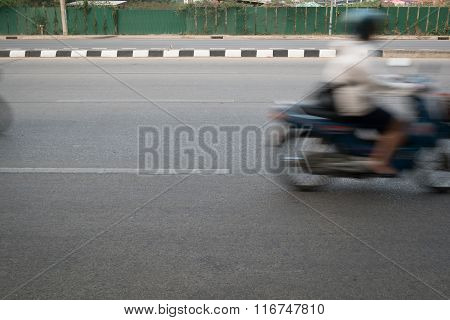 Motorcycle Fast Motion Blurred Driving On Road
