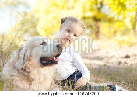 Cute kid girl with dog