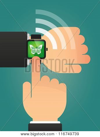 Hand Pointing A Smart Watch With A Butterfly