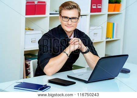 Young businessman working with laptop at the office.