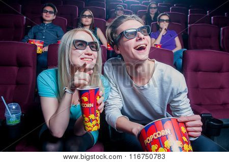 People in the cinema wearing 3d glasses