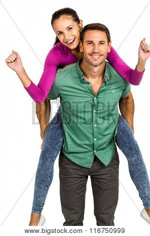 Cheerful man giving piggy back to his girlfriend on white screen