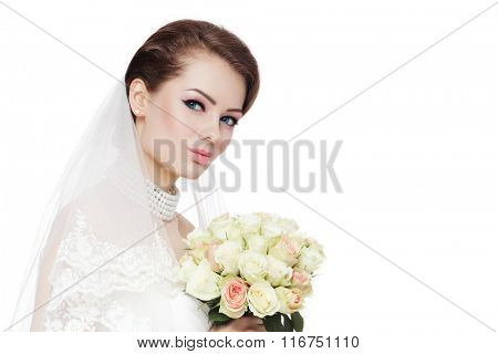 Young beautiful bride with stylish make-up and hairdo holding bouquet over white background, copy space