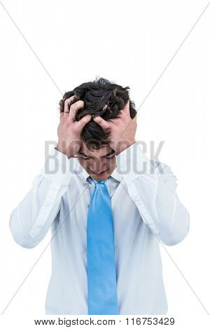 Irritated asian businessman holding his head on white screen