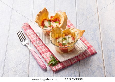 creative little lasagne on glass bowl