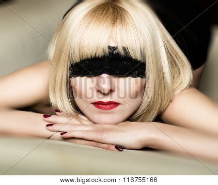 Close up portrait of beautiful sexy young blonde woman  with a bandage on his eyes, put her head in