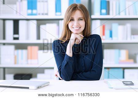 Confident Businesswoman At Desk