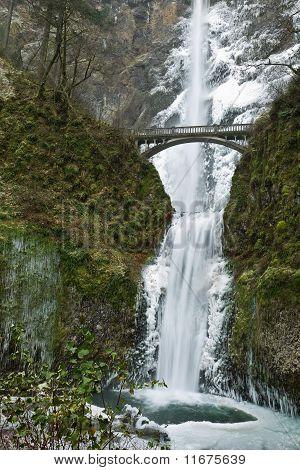 Multnomah Waterfalls frozen in winter.