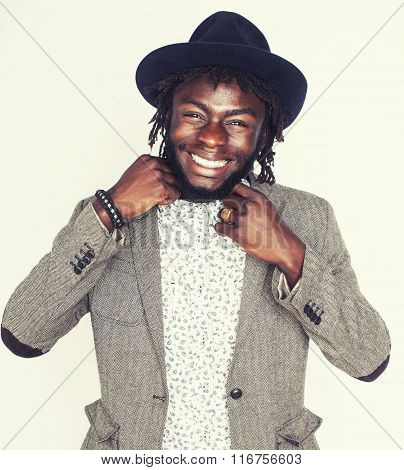 young handsome afro american boy in stylish hipster hat gesturing emotional isolated on white backgr