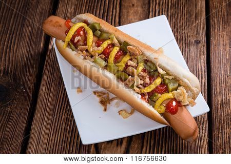 Fresh Made Hot Dog With Fried Onions And Cucumbers