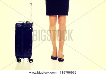 Businesswoman legs with a suitcase