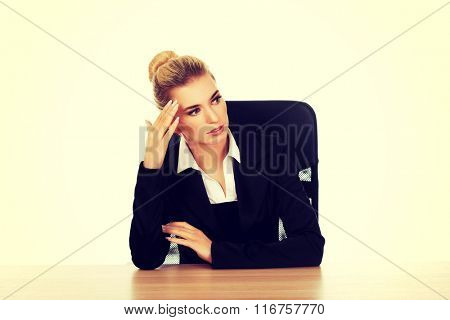 Beautiful businesswoman having huge headache