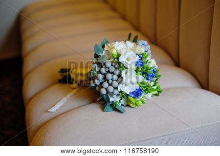 Beautiful Bridal Bouquet Lying On The Sofa