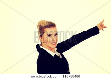 Young businesswoman pointing at something