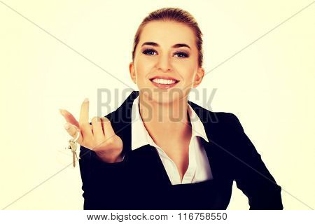 Smile businesswoman real estate agent giving keys
