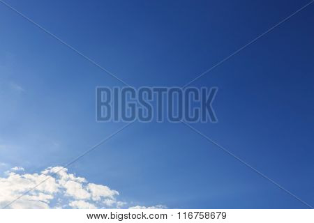 Sunlight Through Cloud On Clear Blue Sky Background