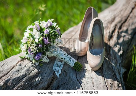 Beautiful Wedding Bouquet And Shoes For The Bride Standing On A Tree In The Park