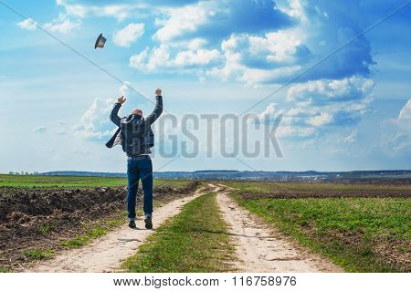 Man Walks Along A Dirt Road And Enjoy The Freedom