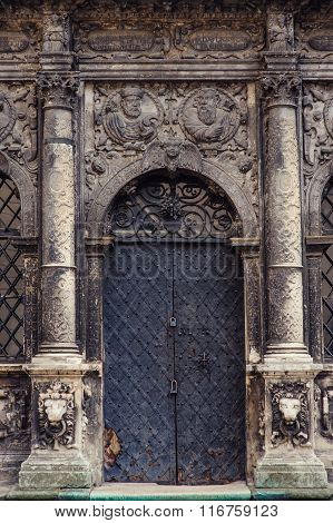 Black Metal Doors And Two Pillars On Each Side In A Church