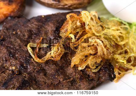 Grilled pork meat with roasted onion.