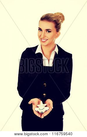 Beautiful businesswoman holding airplane miniature