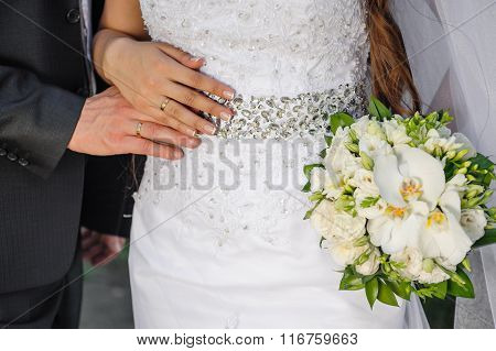 Bride And Groom Keep The Bridal Bouquet