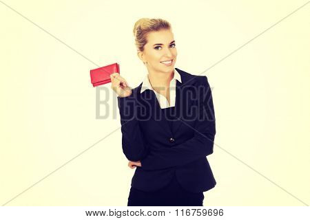 Happy smiling businesswoman with red wallet