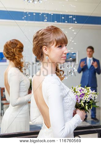Elegant Bride In Wedding Palace With Her Groom On Background