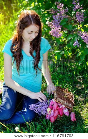 Beautiful Woman Puts Flowers In The Basket