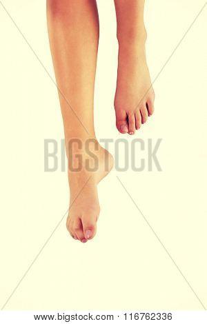 Woman's bare feet.