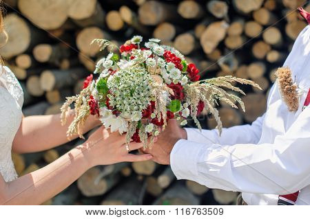 Groom Gives The Bride A Beautiful Wedding Bouquet