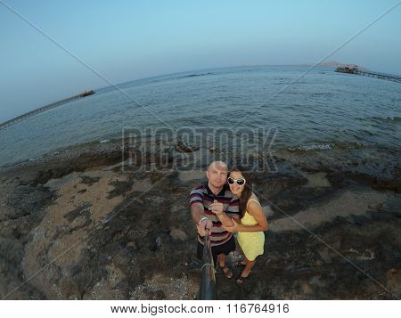 Happy, Young Couple Taking Selfy On The Beach