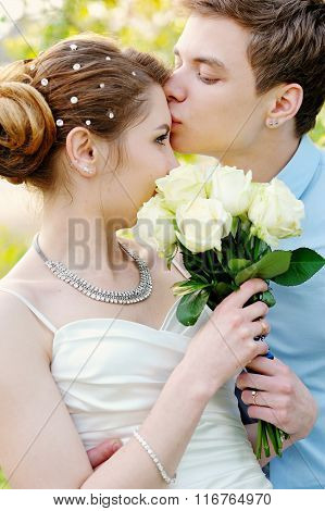 Groom Kisses The Bride On Walk On Their Wedding Day