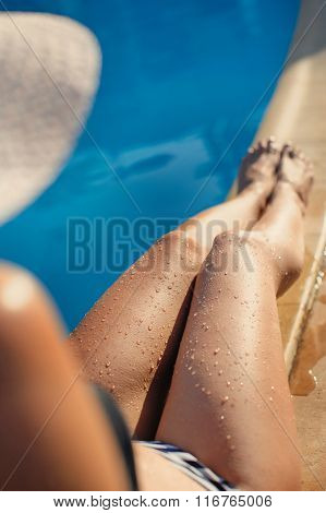 Woman With Hat Near Swimming Pool In Tropical Resort