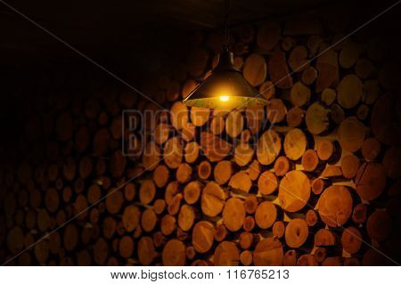 Big Wall Made From Brown Log Wood And Lamp