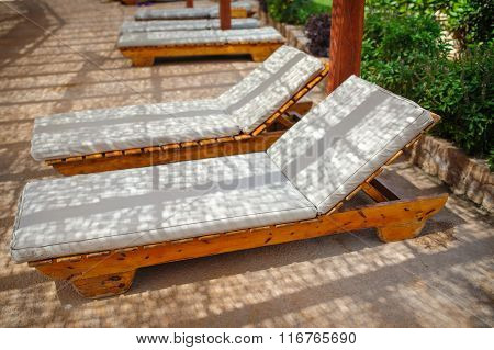 loungers by the pool at the recreation center